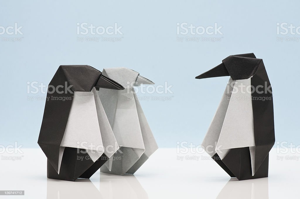 Origami - penguin family - father, mother and child royalty-free stock photo
