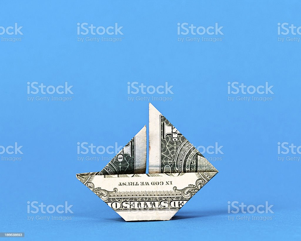 boat made origami from dollar bills.isolated on a white background ... | 820x1024