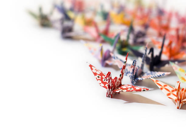 Origami swans in a group on white stock photo