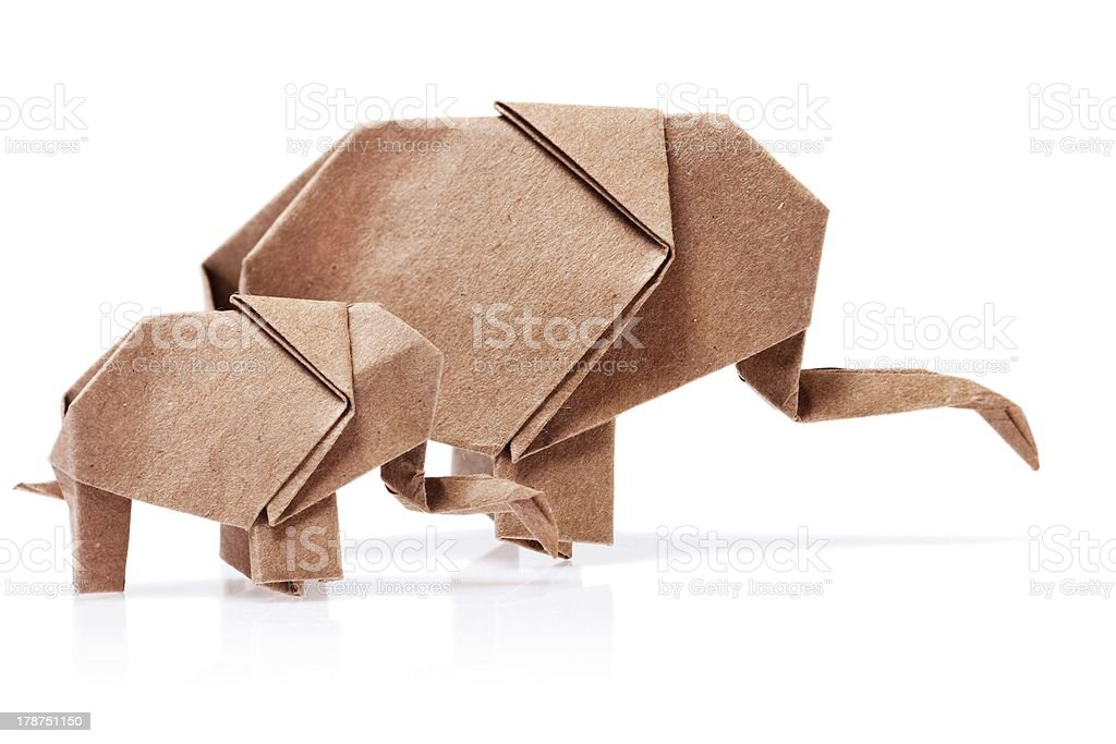 Origami two elephants out of brown paper isolated on white royalty-free stock photo