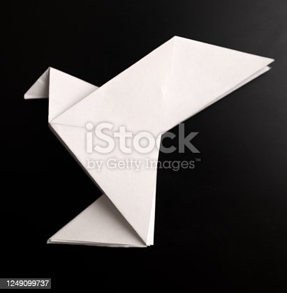 Origami dove on a black background
