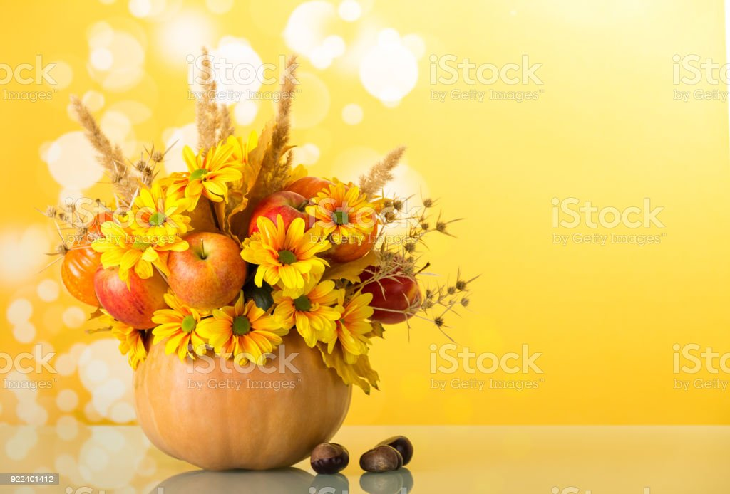 Original Bouquet From Flowers And Fruits In Pumpkin Vase Next To