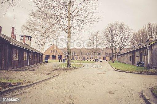 Oswiecim, Poland - April 3, 2015:Original brick and wooden barracks street view in Auschwitz II / Birkenau concentration camp in Oswiecim, Poland.