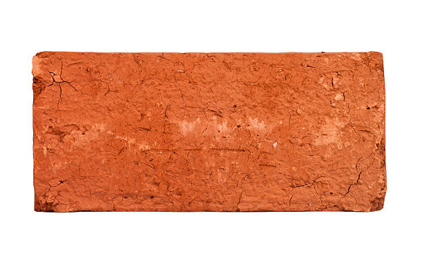 original Brick Straight on closeup shot of a solitary red brick used in construction and home building. single object stock pictures, royalty-free photos & images