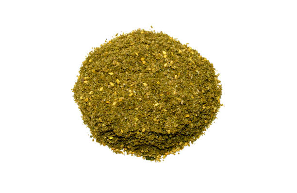 Original Israel and Arabic Za'atar spice isolated on white background. Original Israel and Arabic Za'atar spice isolated on white background. Pile of Middle eastern traditional spice mixture zaatar. Top view zaatar spice stock pictures, royalty-free photos & images