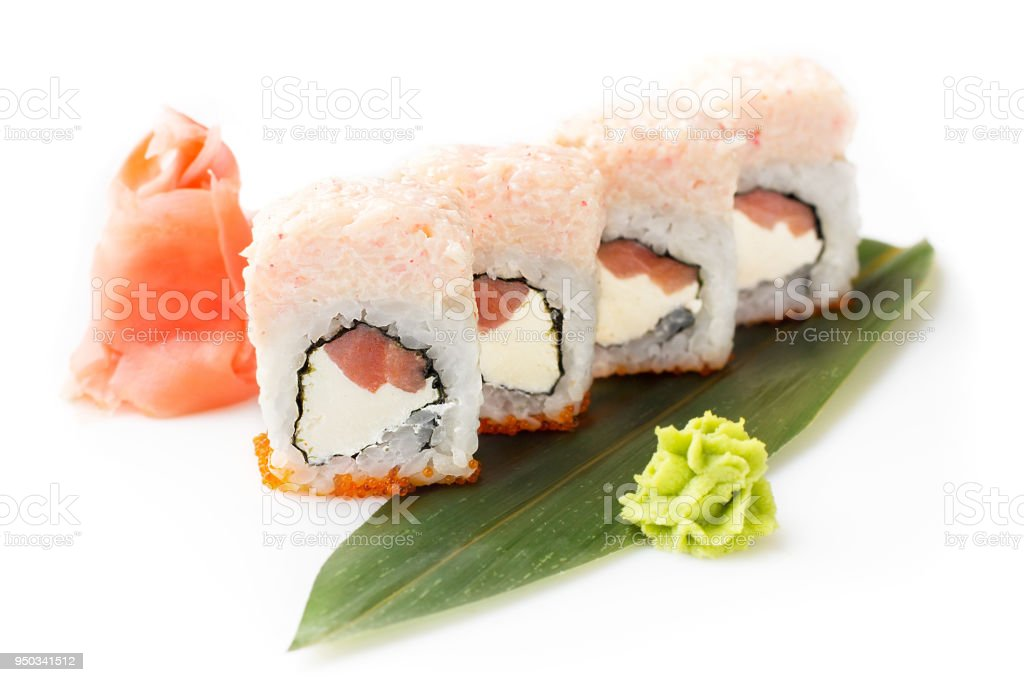 Original sushi rolls with tuna and tender crab mousse laid out on a...