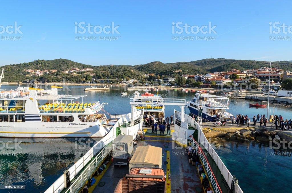 OURANOPOLIS, GREECE - OCTOBER 22, 2017: Original touristic cruise ships in bay near Athos mount stock photo