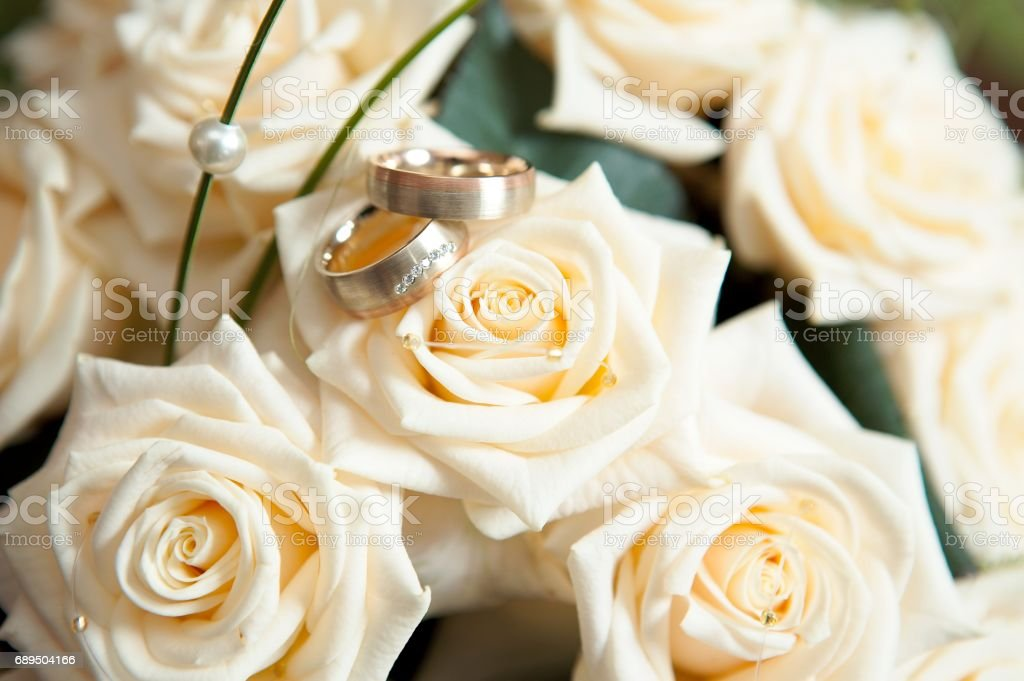 Original Wedding Rings On Beautiful White Roses Bouquet Royalty Free Stock Photo