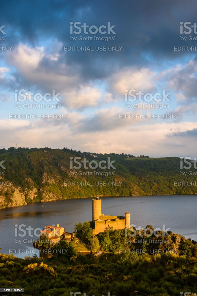 Originally located on a promontory overlooking the Loire gorges, the Grangent castle stands on an island since the building of the Grangent dam in 1957. royalty-free stock photo