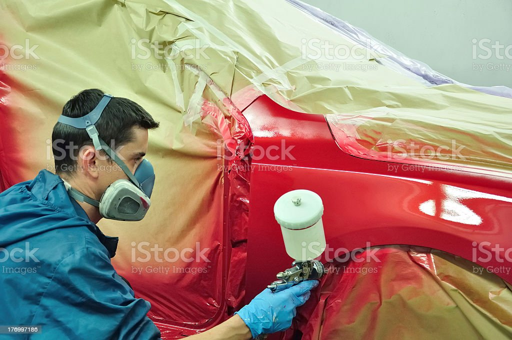 orker painting a car. stock photo