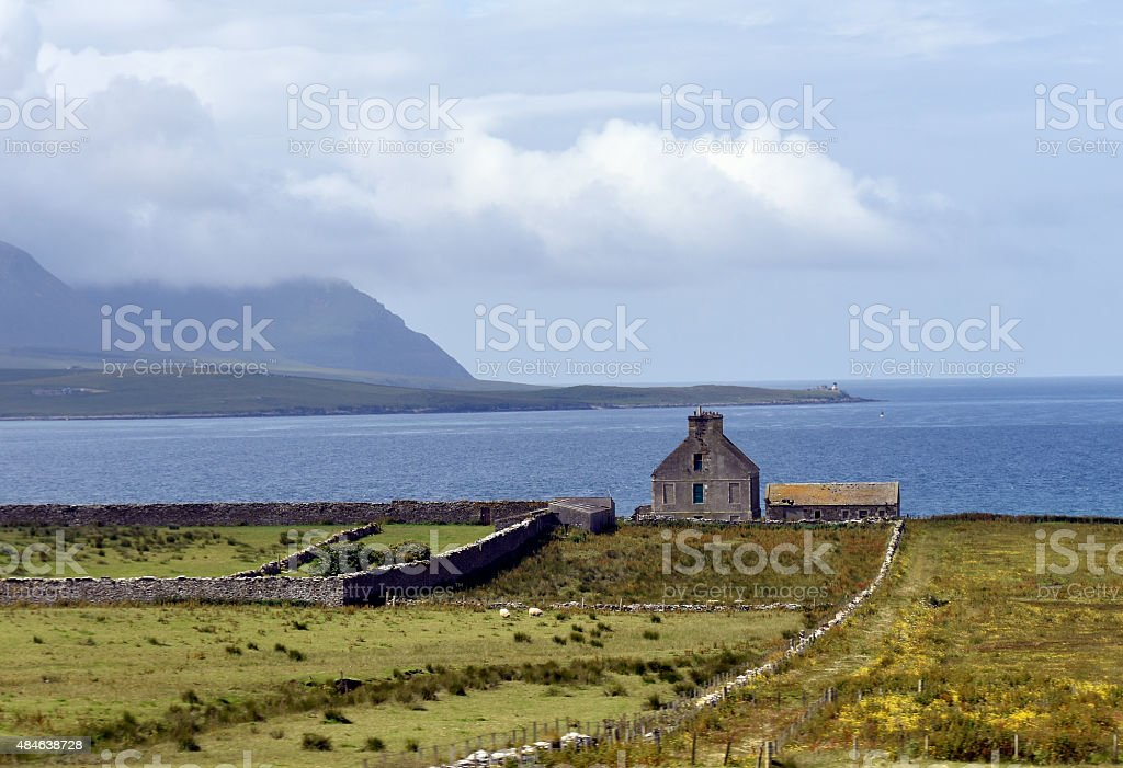 Orkney Islands seascape with lighthouse stock photo