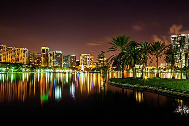 Orlando downtown skyline over Lake Eola at night stock photo