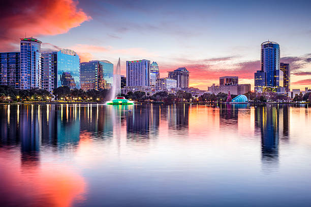 orlando, florida skyline at sunset  - orlando florida photos stock photos and pictures