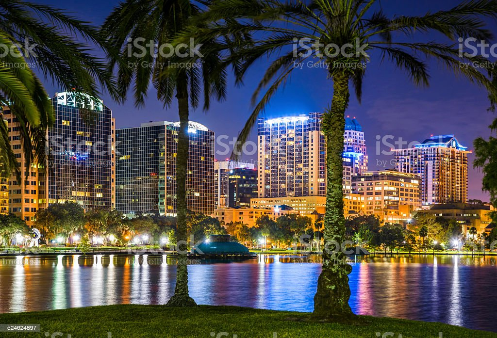 Orlando Florida, skyline, Lake Eola, cityscape, skyscrapers, reflections, water, night stock photo