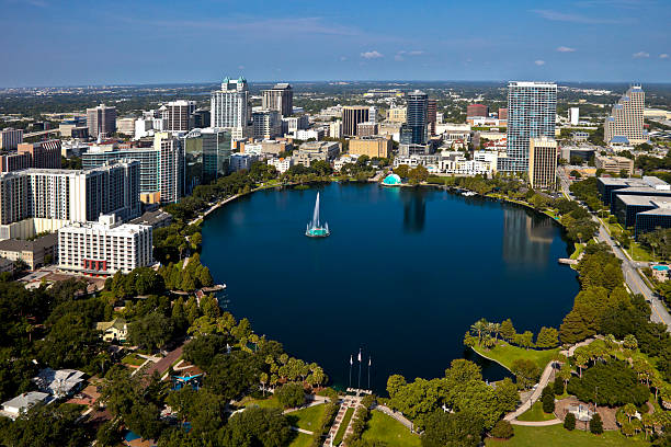 orlando, florida skyline - orlando florida photos stock photos and pictures