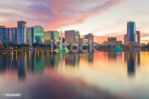 Orlando, Florida, USA downtown city skyline from Eola Park at dusk.