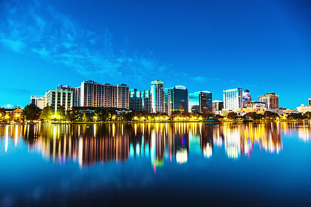 orlando skyline at twilight - orlando florida photos stock photos and pictures