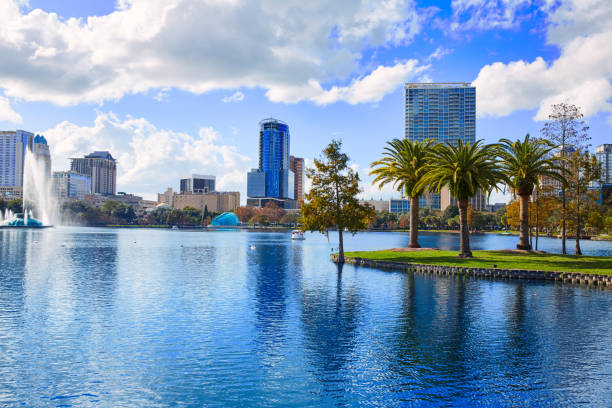 orlando skyline fom lake eola florida us - orlando florida photos stock photos and pictures