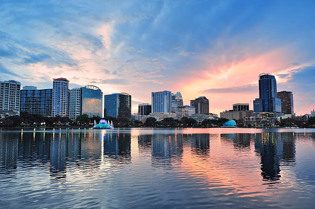 orlando sunset over lake eola - orlando florida photos stock photos and pictures