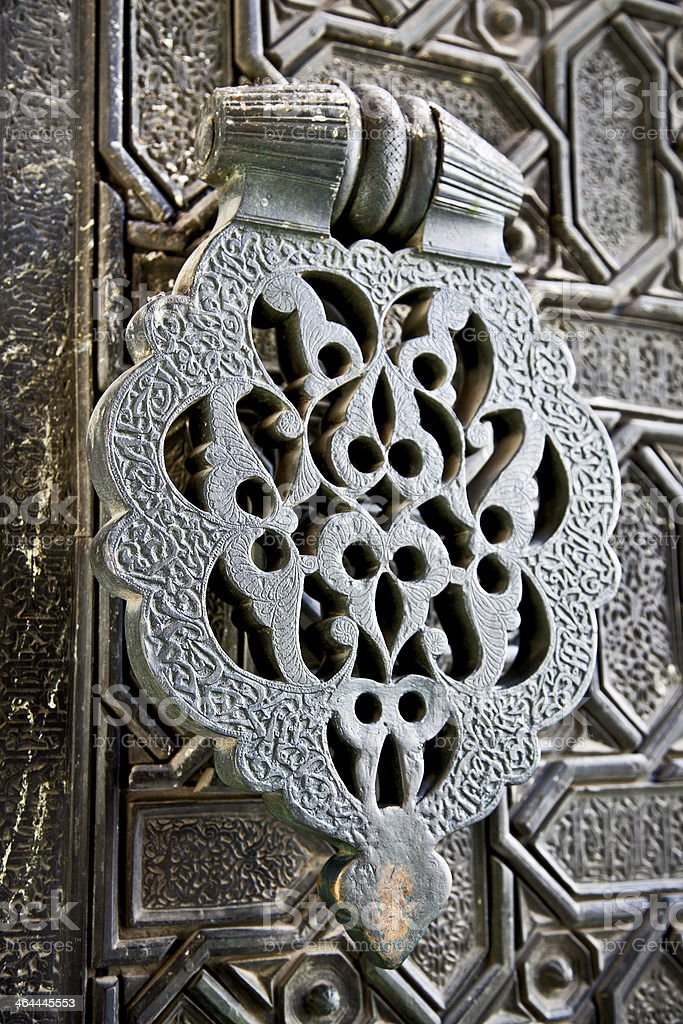 Ornament door handle . Cathedral in Seville, Spain royalty-free stock photo