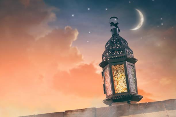 Ornamental Arabic lantern with burning candle stock photo