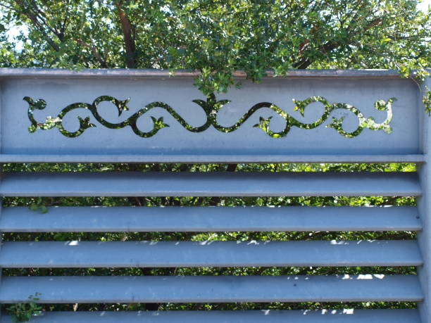 Ornamental Fence With Changing Backgrounds stock photo
