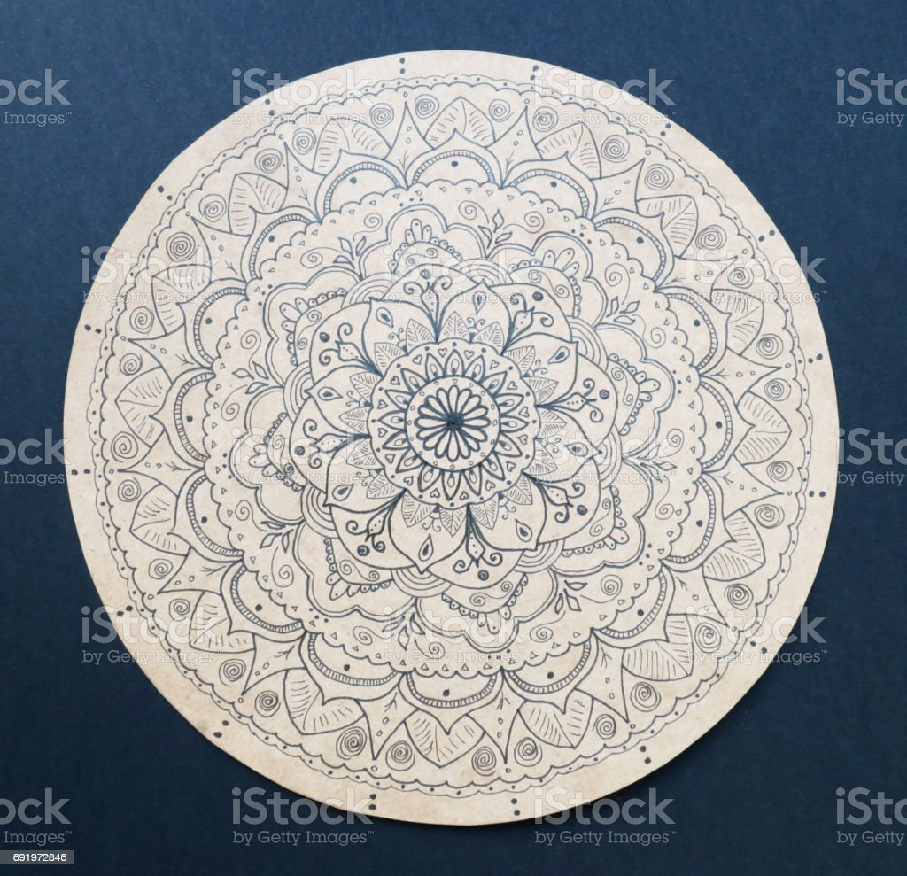 Ornamental flower mandala hand painted stock photo