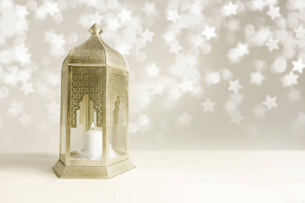 ornamental golden arabic lantern on the table with glittering star-shaped bokeh lights. greeting card for muslim community holy month ramadan kareem. festive blurred background with empty space - ramadan stock photos and pictures