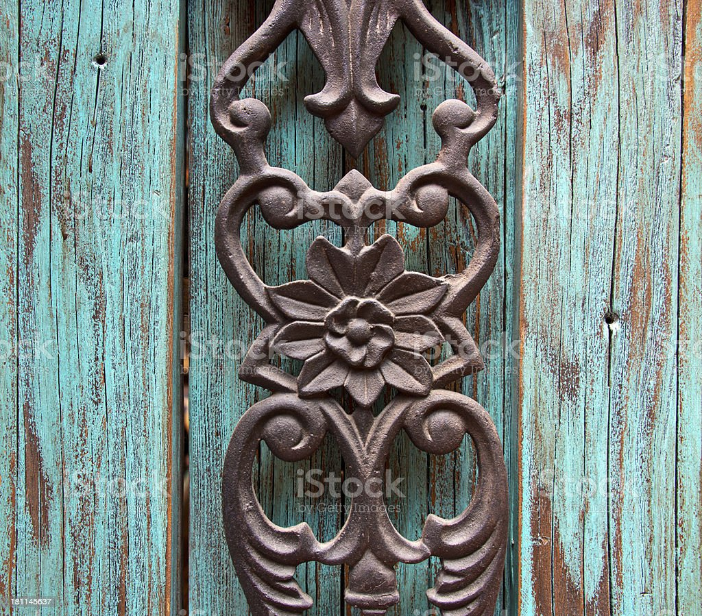 Ornamental Metal Carving on Wood Background stock photo