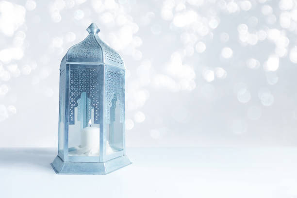 ornamental silver and blue arabic lantern on the table with glittering bokeh lights. greeting card for muslim community holy month ramadan kareem. festive blurred background with a lot of empty space - eid stock pictures, royalty-free photos & images