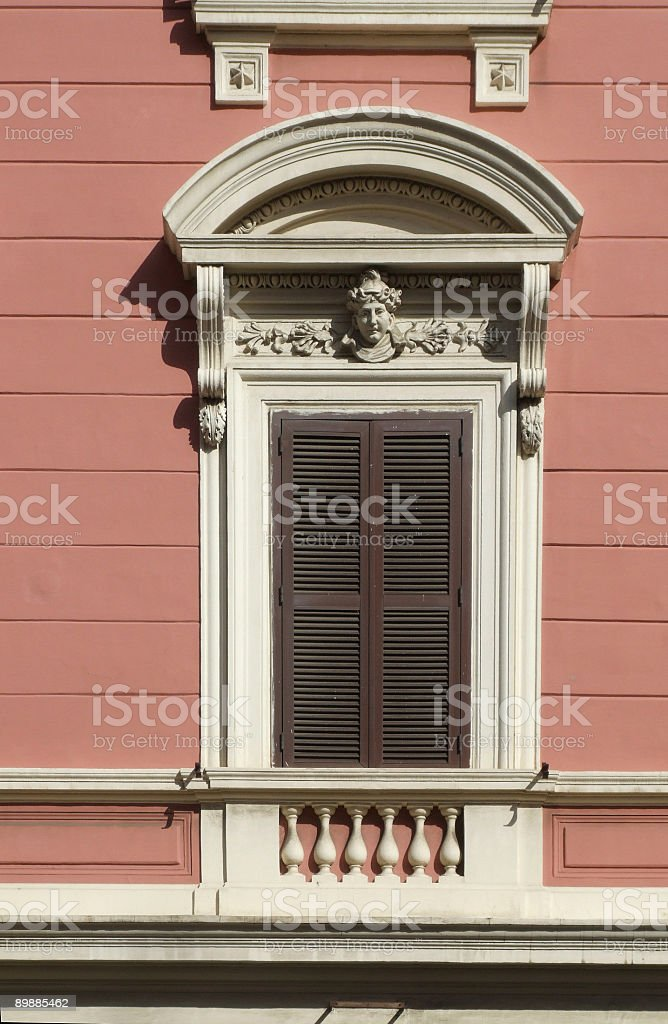 Ornamented window in Rome (Italy) royalty-free stock photo