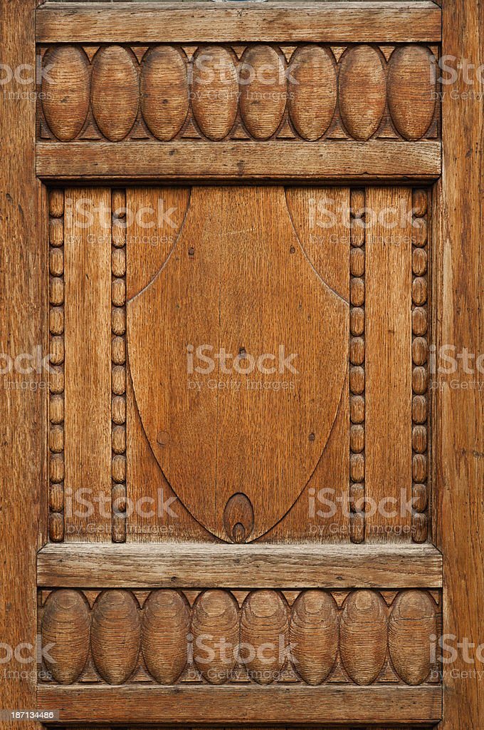 Ornaments of an old wooden door royalty-free stock photo