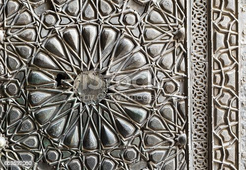 Ornaments of the bronze-plate ornate door of Sultan Barkouk Mosque, an ancient historic mosque in Old Cairo, Egypt