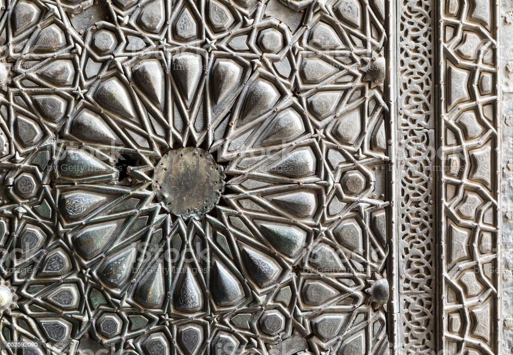 Ornaments of the bronze-plate ornate door of Sultan Barkouk Mosque, Cairo, Egypt stock photo