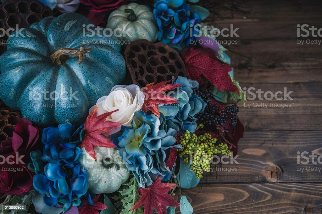 Ornate blue themed fall wreath with blue pumpkins stock photo