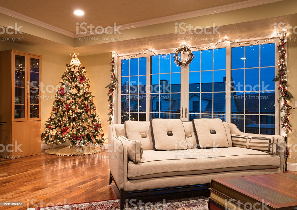 Ornate Christmas Tree in corner of modern home stock photo