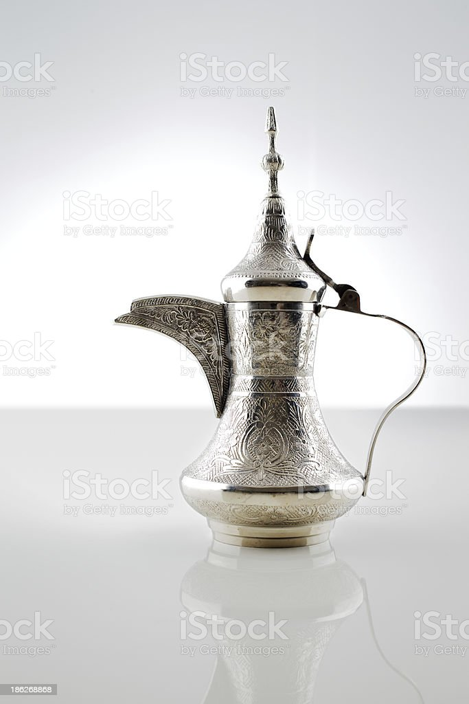 Ornate dallah is a metal pot for making Arabic coffee stock photo