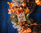Ornate fall wreath with pumpkins, pinecones, message and leaves