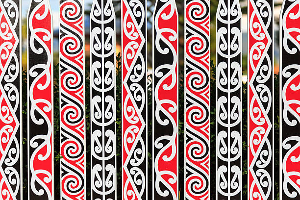ornate fance with maori pattern - maori stock photos and pictures