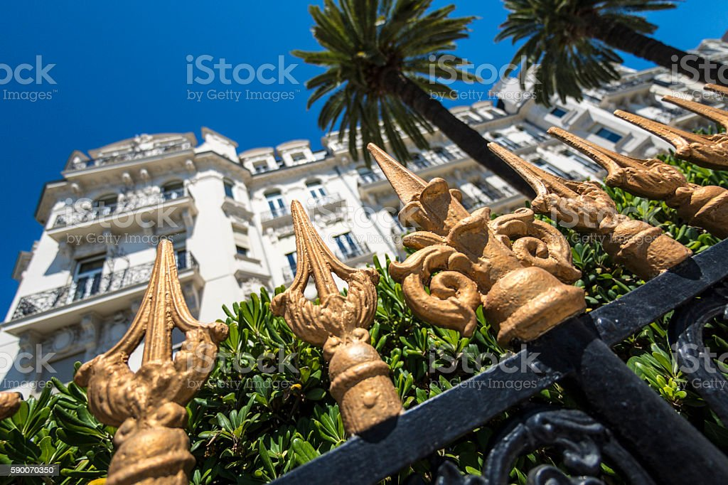 Ornate fence and hotel in Nice, France stock photo