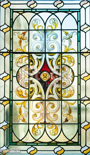 Ornate floral pattern in a stained glass window at the Victoria Legislative Building in Victoria, British Columbia, Canada.(Public building)