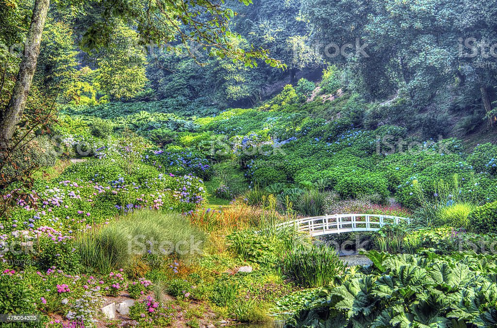 Ornate Gardens bridge, valley of trees and flowers stock photo