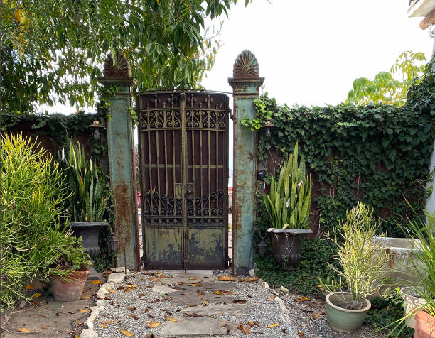 Ornate gate with stone path. stock photo