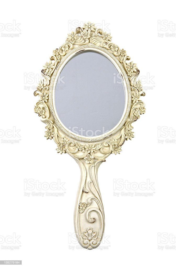 hand mirror. ornate gold hand mirror with flowers stock photo