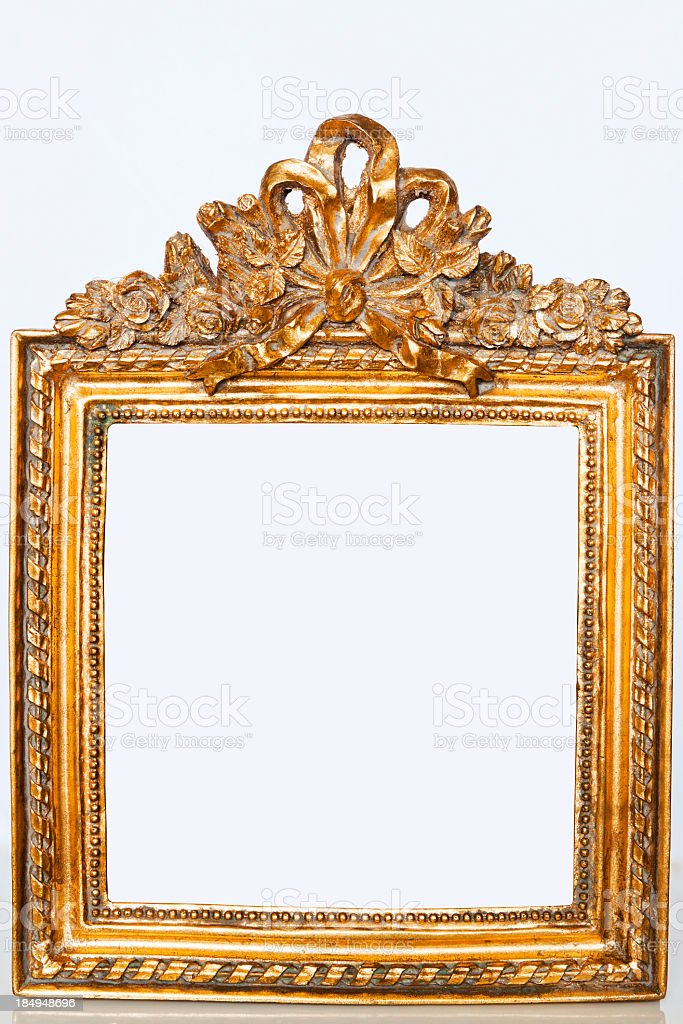 Ornate golden picture frame isolated on white background, copy space royalty-free stock photo