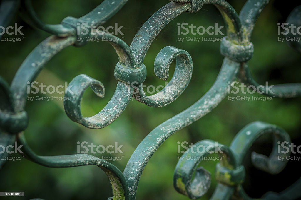 Close up of heart detail in wrought ironwork.