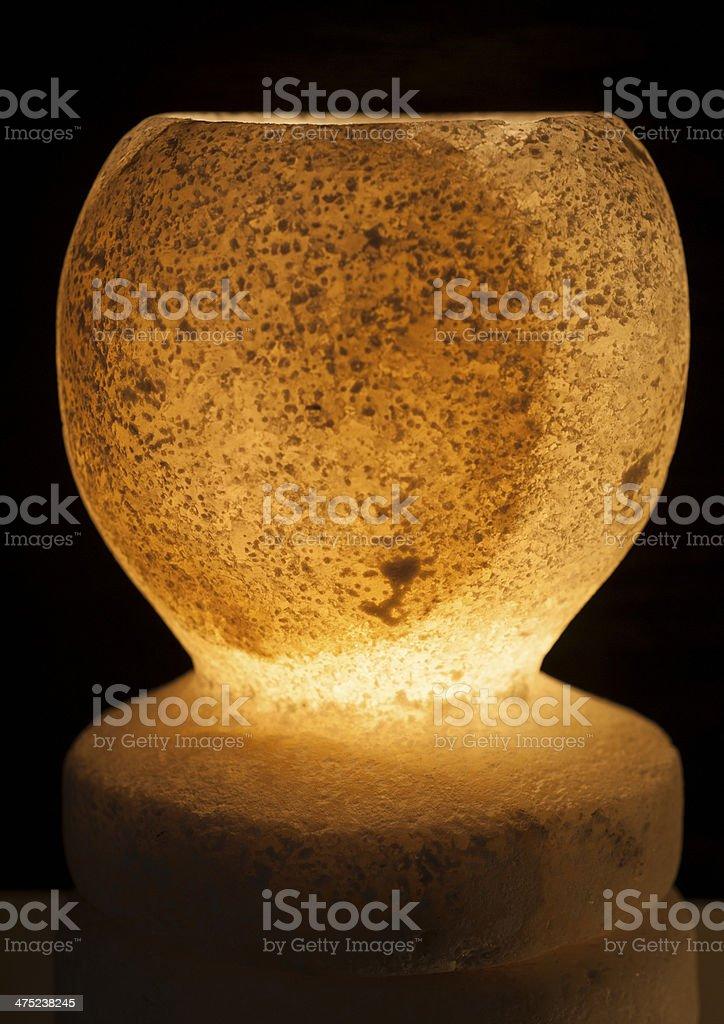Ornate rock salt lamp on black background royalty-free stock photo