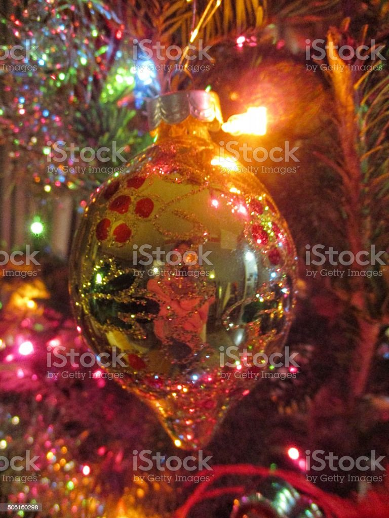 Ornate Sparkling Christmas Ornament on a Christmas Tree stock photo