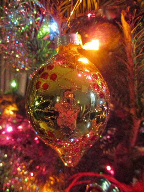 Ornate Sparkling Christmas Ornament on a Christmas Tree stock photo