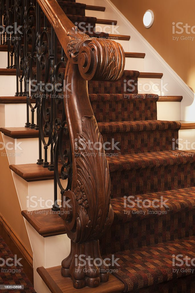 Ornate staircase hand rail and balusters detail in home. stock photo